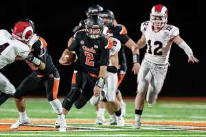 Jake Roberts (2) of Shelton High School runs the ball on a quarterback keeper during a game between New Canaan High School and Shelton High School on November 27, 2018 at Shelton High School in Shelton, CT.