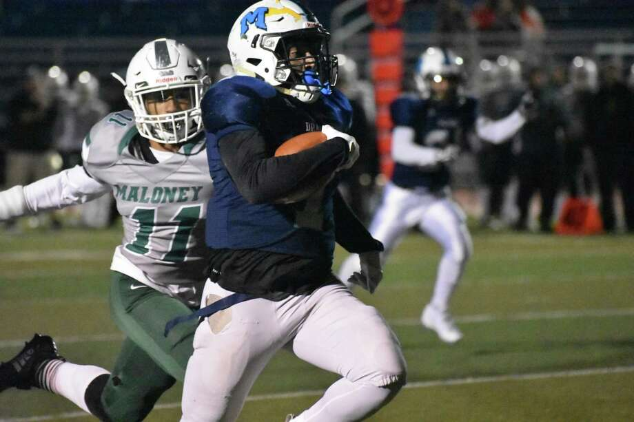 Middletown's Xzavier Reyes rushes for a touchdown against Maloney in the Class L quarterfinals at Middletown on Tuesday, November 27, 2018. Photo: Petet Paguaga / Hearst Connecticut Media