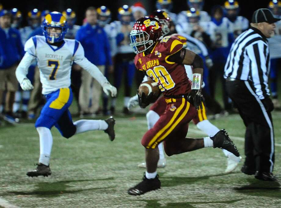 St. Joseph back Jaden Shirden runs up the middle for a huge gain in the first half of the Cadets' blow out victory over Rockville in the Class M football quarterfinals at Penders Field in Stratford, Conn. on Tuesday, November 27, 2018. Photo: Brian A. Pounds / Hearst Connecticut Media / Connecticut Post