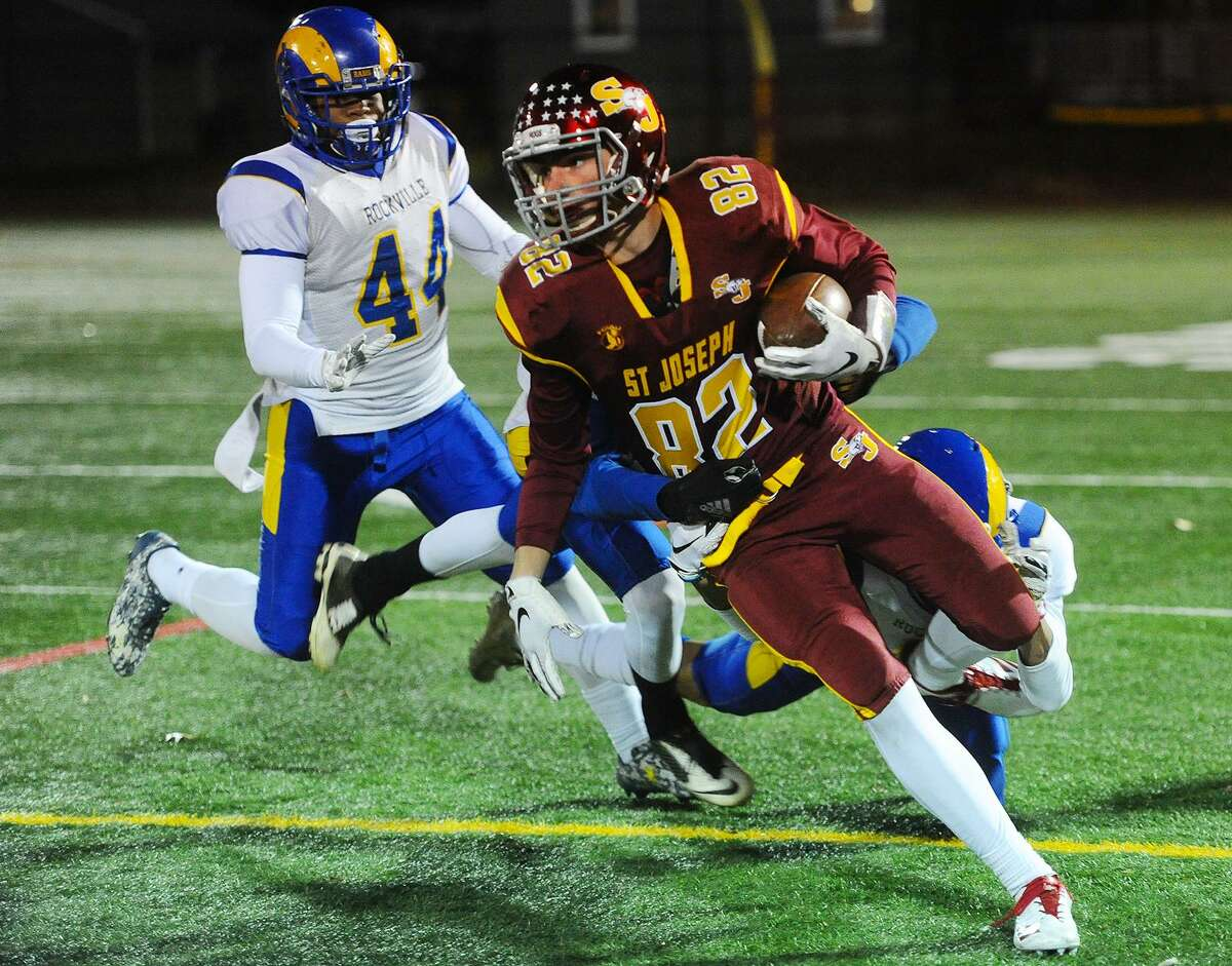 St. Joseph wide out William Diamantis turns the ball upfield on a reception in the first half of the Cadets' blow out victory over Rockville in the Class M football quarterfinals at Penders Field in Stratford, Conn. on Tuesday, November 27, 2018.