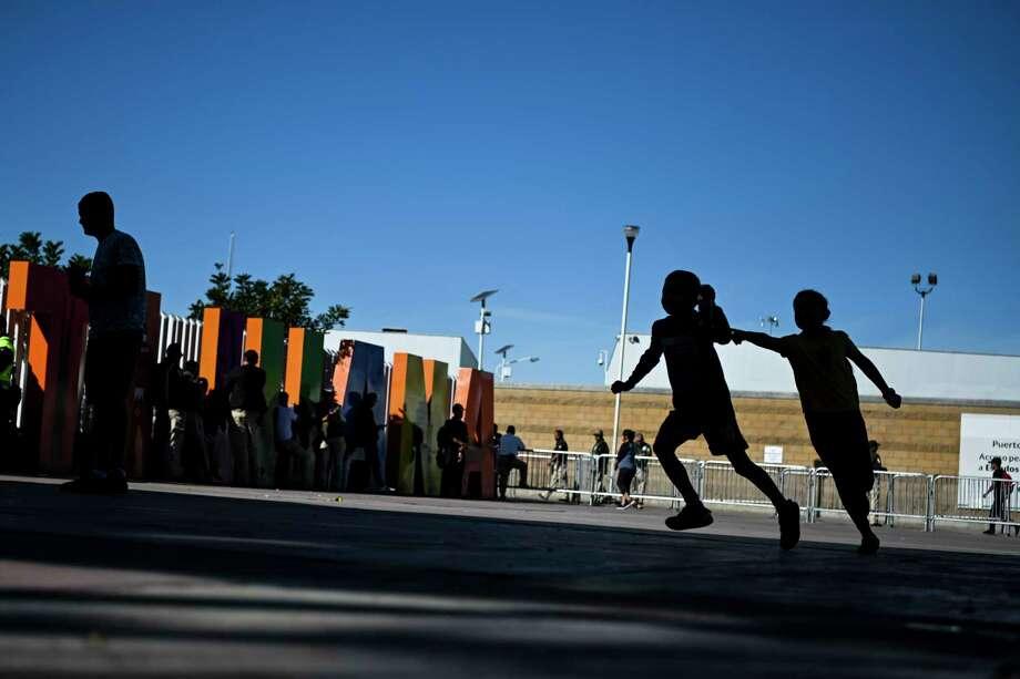 Children play in a plaza at the San Ysidro border crossing in Tijuana, Mexico. Photo: Washington Post Photo By Carolyn Van Houten / The Washington Post