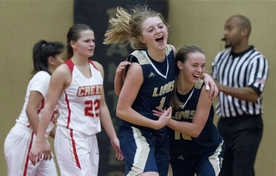 lake creek guards makenzie logeman 1 and collette taylor 10 react after