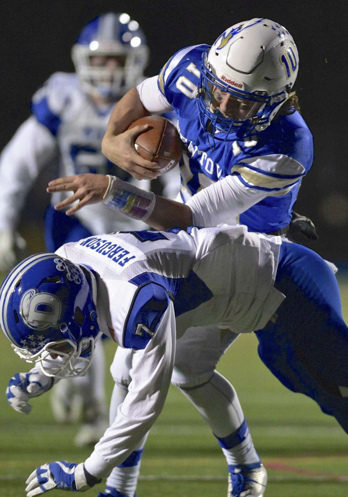 Newtown quarterback Luke Melillo (10) runs into Darien's Bruce Ferguson (7) as he scrambles out of the backfield and gains enough yardage to get a first-and-goal.