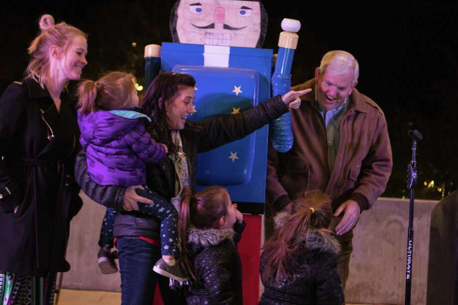 President of First National Bank in Conroe George Waggoner, his wife Sheila Waggoner and their family react after pulling the switch to light the Conroe Christmas Tree during the annual Tree Lighting Ceremony on Tuesday, Nov. 27, 2018 at Heritage Place Park in Conroe. Photo: Cody Bahn, Houston Chronicle / Staff Photographer / © 2018 Houston Chronicle