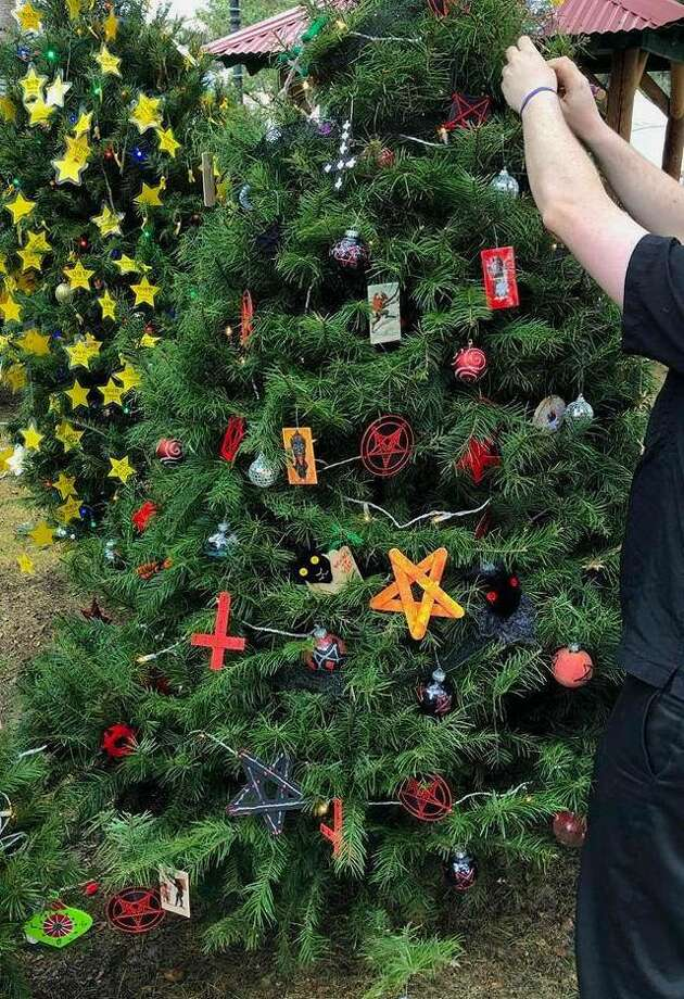 The Satanic Bay Area group said Tuesday that a number of its ornaments were taken from their tree at Christmas in the Park in San Jose over the weekend. The group handmade about 140 of the ornaments, and expect they will have to replenish the tree in two weeks if items continue to be stolen. Photo: Courtesy Satanic Bay Area