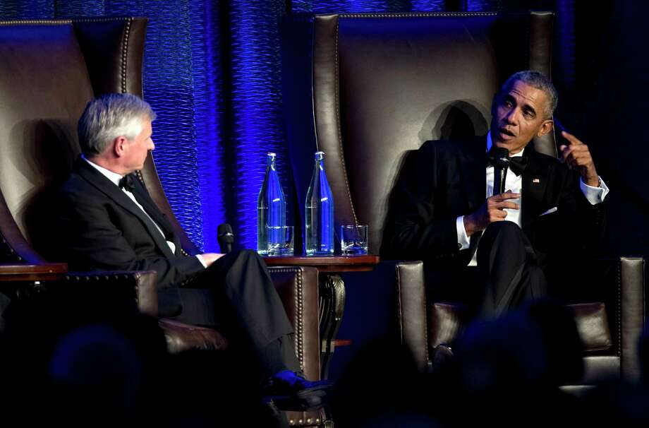 Former President Barack Obama speaks with Jon Meacham as he takes the stage during the 25th anniversary gala celebration for Rice University's Baker Institute for Public Policy on Tuesday, Nov. 27, 2018, in Houston. Photo: Brett Coomer, Staff Photographer / © 2018 Houston Chronicle