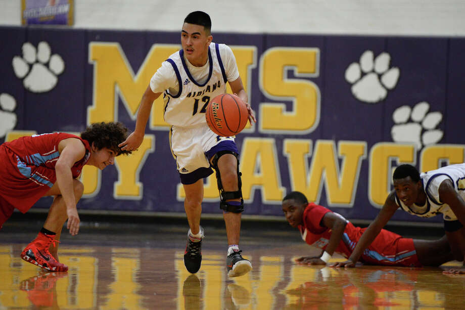 Midland High's Nicholas Terrazas (12) dribbles down the court after recovering a loose ball from Lubbock Monterey Nov. 27, 2018, at Midland High. James Durbin/Reporter-Telegram Photo: James Durbin / ? 2018 Midland Reporter-Telegram. All Rights Reserved.