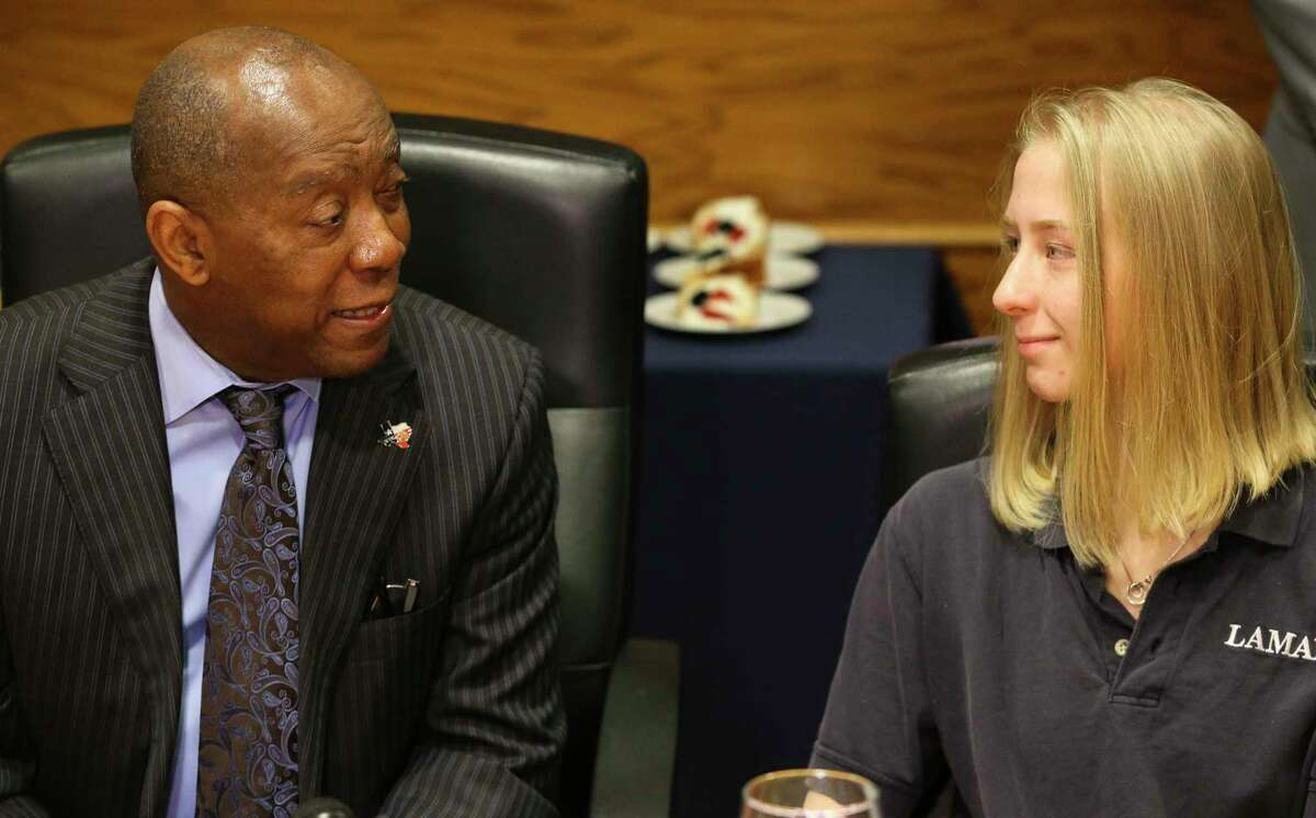 Lamar High School Senior Elizabeth Nelson-Fryar, 17, sits next to Houston Mayor Sylvester Turner during a lunch meeting with more than a dozen Lamar High School students on Tuesday, Nov. 27, 2018, in Houston. The meeting was sparked by Elizabeth writing a letter to Turner and told him that she was losing hope following recent shooting outside of the high school that killed one student. Several city and Houston Independent School District officials also joined the meeting.