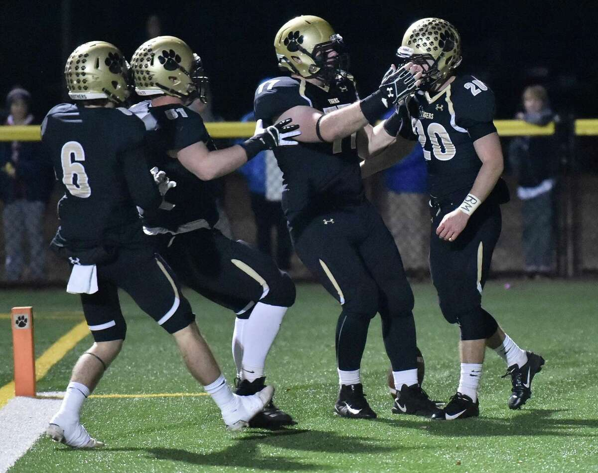 Madison, Connecticut - November 27, 2018: #1 Daniel Hand H.S. vs. #8 Bunnell H.S. during the first half of CIAC Class L Football Tuesday night at Strong Field in Madison. Hand H.S. defeats Bunnell H.S. 56-0.