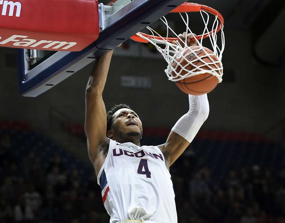 UConn's Jalen Adams (4) dunks during the second half of an NCAA college basketball game against UMass-Lowell, Tuesday, Nov. 27, 2018, in Storrs, Conn. (AP Photo/Stephen Dunn) Photo: Stephen Dunn, Associated Press