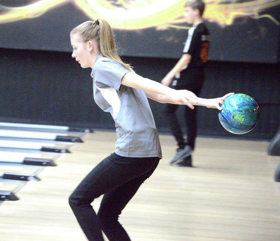Edwardsville's Emilie Fry bowls during Tuesday's Southwestern Conference opener against Alton at Edison's Entertainment Center. Photo: Scott Marion/Intelligencer