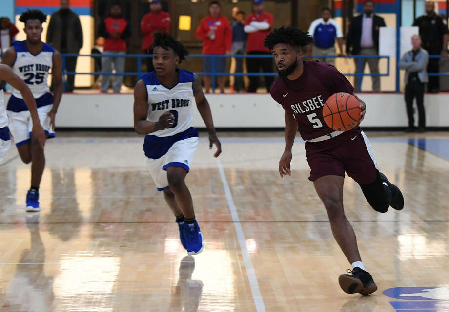 Silsbee's Jordyn Adams drives the ball against West Brook at the Bruin's gym Tuesday night.