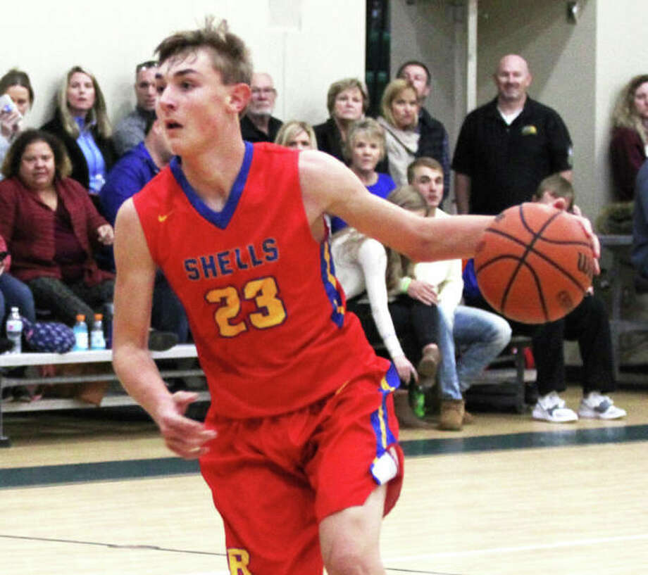 Roxana's Gavin Huffman, shown in a game at the Metro-East Lutheran Tournament last week, scored 27 points Tuesday night in the Shells' victory over EA-WR at Roxana. Photo: Greg Shashack / The Telegraph