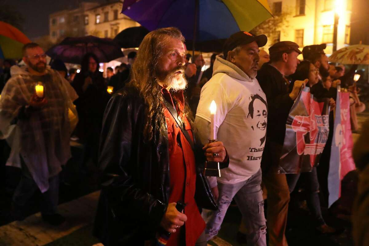 Bo Ayres marches down Market Street during annual candlelight walk from The Castro to City Hall in memory of Harvey Milk and Mayor George Moscone, who were slain 40 years ago in San Francisco, Calif.. Photographed on Tuesday, November 27, 2018.