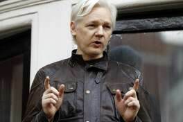 "FILE - In this May 19, 2017 file photo, WikiLeaks founder Julian Assange gestures to supporters outside the Ecuadorian embassy in London, where he has been in self imposed exile since 2012. Former Trump campaign chairman Paul Manafort is denying that he ever met WikiLeaks founder Julian Assange. Manafort says in a statement that a Guardian report saying he met with Assange at the Ecuadorian embassy is ""totally false and deliberately libelous."" Manafort says that he has never been contacted by ""anyone connected to WikiLeaks, either directly or indirectly."" (AP Photo/Frank Augstein, FILE)"