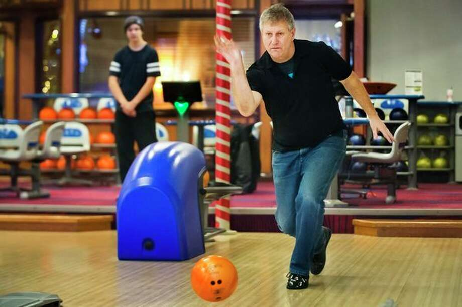 Let the bowl-a-thon begin 				Curt Zastrow, founder of The Children's Heritage Foundation, right, bowls with his son, Cam Zastrow, 17, left, as the two spend 24 consecutive hours bowling as part of a fundraiser for the foundation on Tuesday afternoon at Valley Lanes. (Katy Kildee/kkildee@mdn.net)
