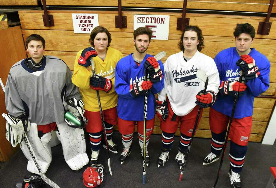 Albany hockey players; Joe Rosi, left, Matt Trippany, Yoni Eligberg, Chris Gallagher and Patrick Trippany, right, with the Niskayuna/Schenectady/Albany Mohawks hockey team on Monday, Nov. 26, 2018, in the Messa Rink at Union College in Schenectady, N.Y. Five players from Albany were added to the team for the first time this season. (Will Waldron/Times Union) Photo: Will Waldron / 20045552A
