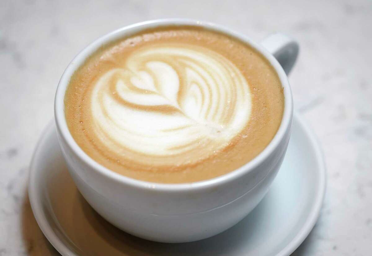 A latte is one of many drinks offered by Amaya Coffee, one of 10 eating establishments and two full bars in the new Finn Hall food court in downtown Houston.