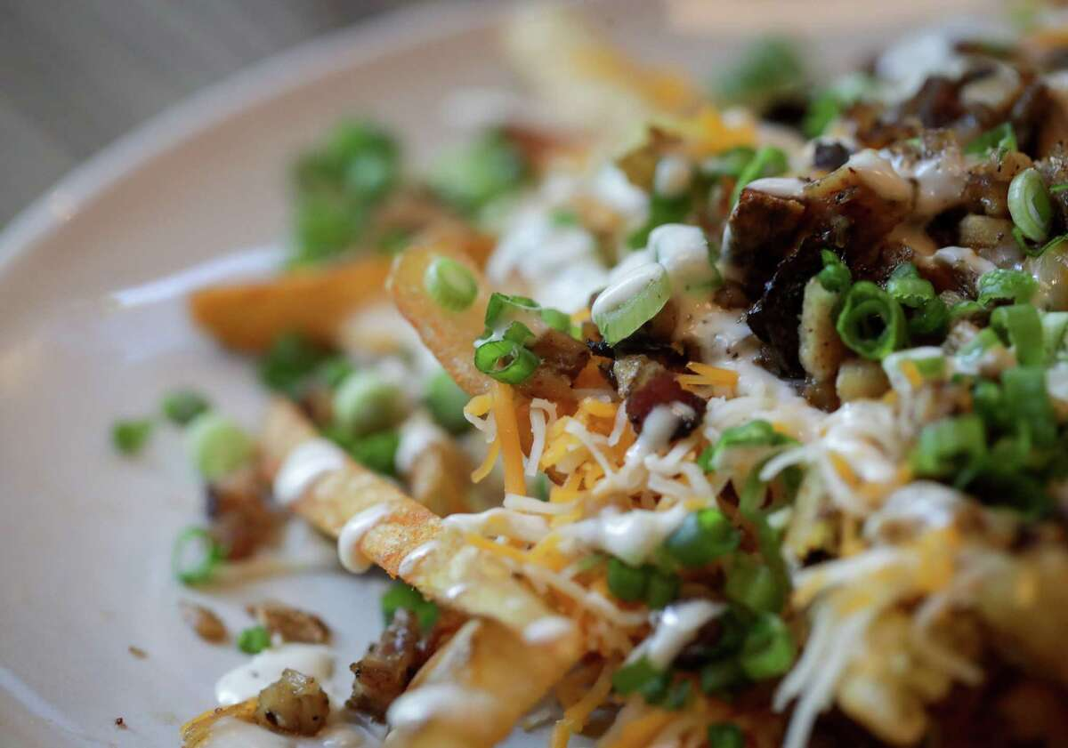 Loaded fries from Craft Burger, one of the new operators at Finn Hall food hall in downtown Houston.