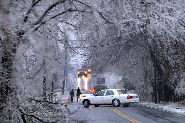 STEVE JACOBS / TIMES UNION , 12/12/08, Loudonville,NY-- ICE DAMAGE -- Officials detour traffic along Osborne Road due to heavy tree damage as a result of an overnight ice storm, Friday morning, december 12,2008 ( FOR WEATHER STORY) 1 of 5 photos