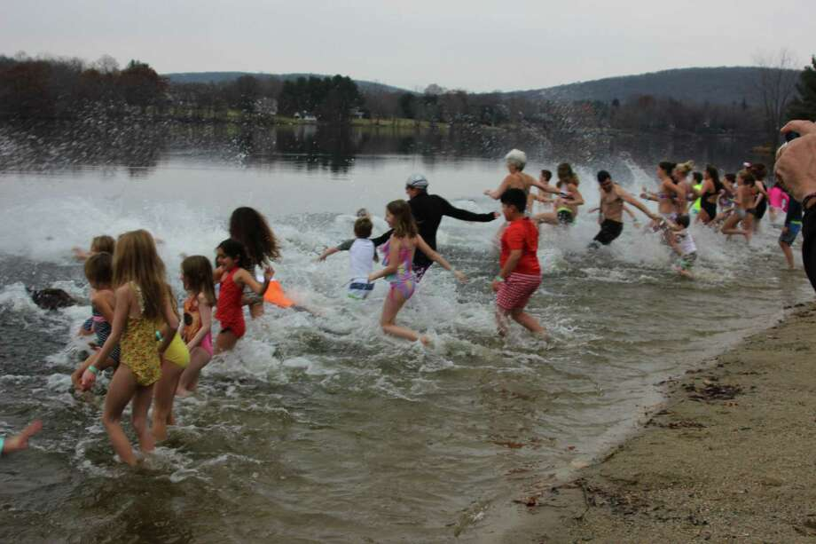 Washington Montessori School will hold its seventh annual Polar Plunge for Partnership Dec. 2 at 11 a.m. at Lake Waramaug State Park Beach. A fundraiser for the Washington Montessori School Community Partnership Program, the Polar Plunge for Partnership is a fun, family-friendly event open to the public. Individuals ages 6 and older are invited to participate. To register and for more information, visit www.takethepolarplunge.com. Photo: Contributed Photo / Contributed Photo / The News-Times Contributed
