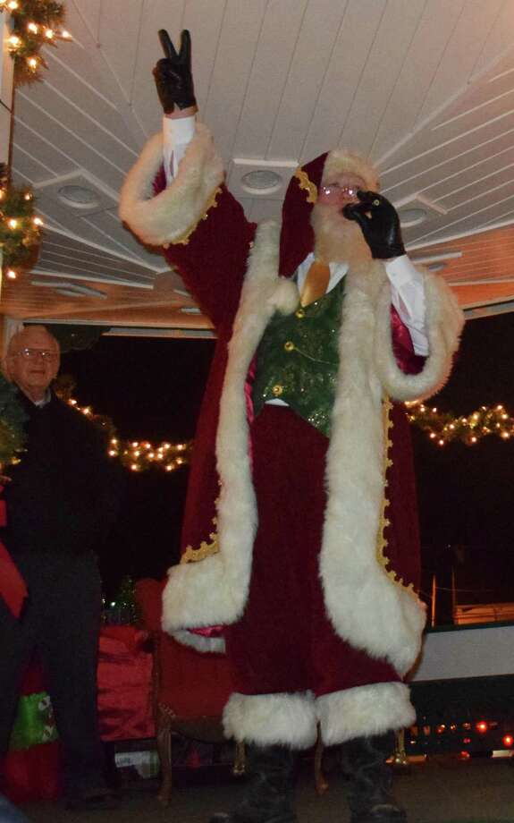 Spectrum/The annual lighting of the trees on the Village Green in New Milford was held Nov. 24, 2018. The event was held by the Greater New Milford Chamber of Commerce. The trees are put up annually by the United Methodist Men at the New Milford United Methodist Church. Above, Santa leads the crowd in counting down to the lighting of the trees. Photo: Deborah Rose / Hearst Connecticut Media / The News-Times  / Spectrum