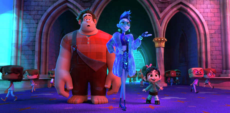 "This image released by Disney shows characters, from left, Ralph, voiced by John C. Reilly, Yess, voiced by Taraji P. Henson and Vanellope von Schweetz, voiced by Sarah Silverman in a scene from ""Ralph Breaks the Internet."" Photo: Disney Via AP, File"