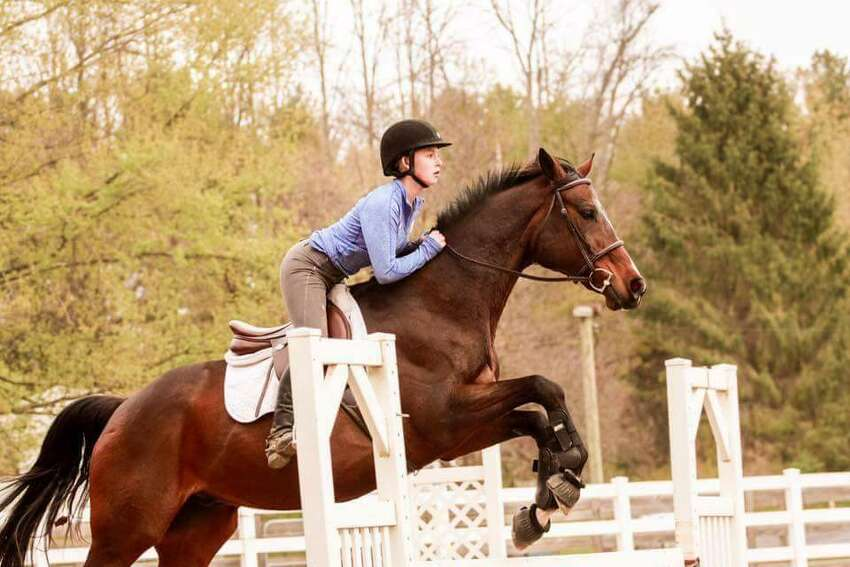 Rylee Grace O'Flaherty, a sophomore honor student at Mohonasen High School in Rotterdam, is a dedicated horse jumper who rides and shows her horse Benton and hopes to find a college where she can study and ride competitively.