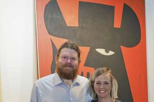Kelly and Juliet Kennedy pose with some of the artwork available in the gallery at Kelly D. Kennedy Fine Art.