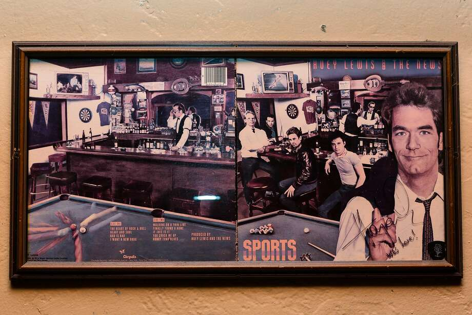 "The Huey Lewis and the News album ""Sports,"" which was photographed at the 2AM Club in Mill Valley, hangs on a wall at the bar. Photo: Constanza Hevia H. / Special To The Chronicle"