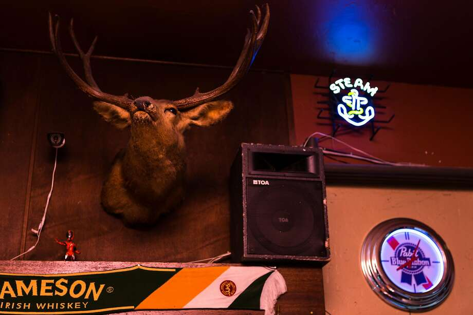 A deer head hangs behind the bar at the 2AM Club in Mill Valley. Photo: Constanza Hevia H. / Special To The Chronicle