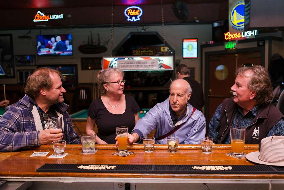 "A week after the raucous invasion of college kids home over Thanksgiving break, the 2AM Club in Mill Valley returns to normal with customers Gary Scheuenstuhl (left), Alexandra French, Michael ""Lippy"" Lipman and Scott Glasscre. Photo: Constanza Hevia H. / Special To The Chronicle"