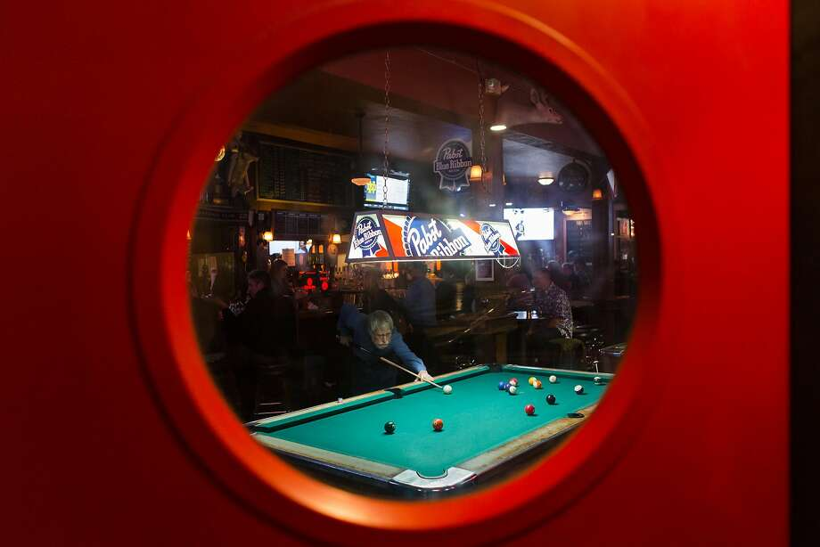 A week after the raucous invasion of college kids home over Thanksgiving break, the 2AM Club in Mill Valley returns to normal with Ed Rusky playing pool. Photo: Constanza Hevia H. / Special To The Chronicle