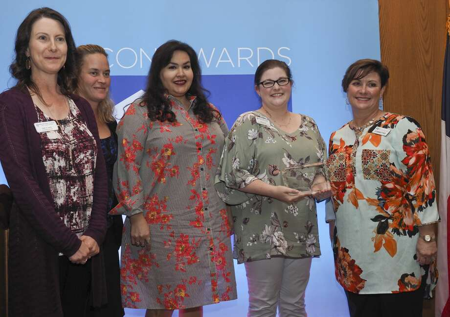 Amy Hendrick, right, 2018 Beacon Awards chair, presents the Excellence in Technology Award to members of Midland Need to Read. Photo: Tim Fischer/Midland Reporter-Telegram