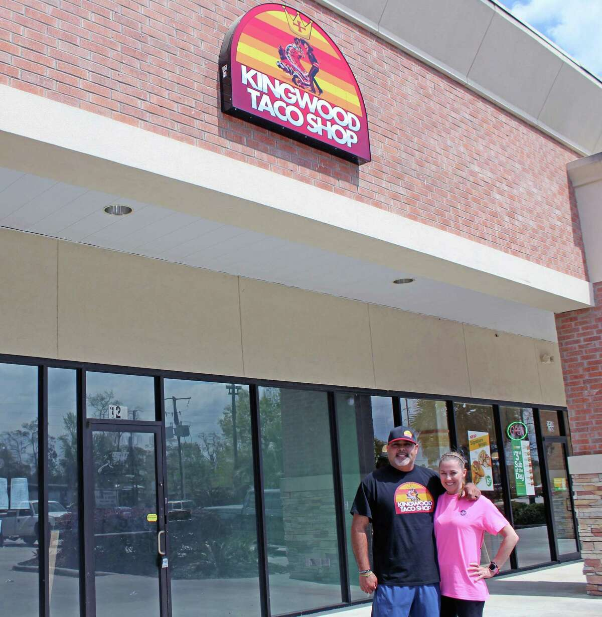 Kingwood Taco Shop Owner Gregory Mata poses in front of his new restaurant with his wife Karen Mata.