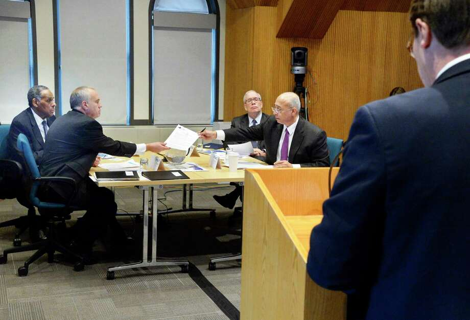 NYS Compensation Committee members, from left, H. Carl McCall, Tom DiNapoli, Scott Stringer and William Thompson, Jr. listen to testimony from Blair Horner, right, of NYPIRG during a public hearing Wednesday Nov. 28, 2018 in Albany, NY. The committee is tasked with recommending raises for state legislators and other public officials.  (John Carl D'Annibale/Times Union) Photo: John Carl D'Annibale, Albany Times Union / 20045588A