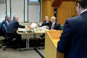 NYS Compensation Committee members, from left, H. Carl McCall, Tom DiNapoli, Scott Stringer and William Thompson, Jr. listen to testimony from Blair Horner, right, of NYPIRG during a public hearing Wednesday Nov. 28, 2018 in Albany, NY. The committee is tasked with recommending raises for state legislators and other public officials.  (John Carl D'Annibale/Times Union)
