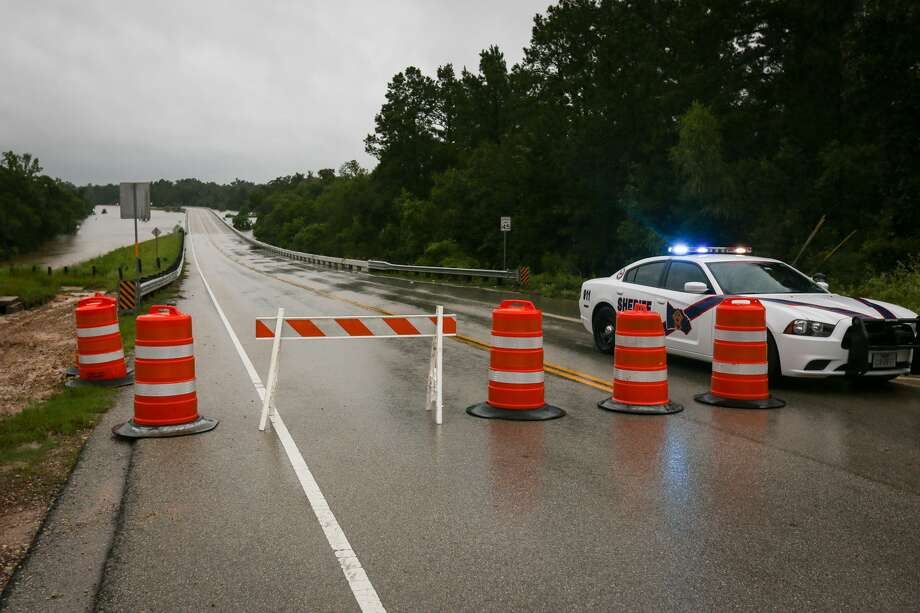 A grant application to complete a feasibility study for a Spring Creek flood detention reservoir has been denied—yet the interested parties have not given up on the project. The Woodlands Township Drainage Task Force meeting members discussed possible workarounds for funding at their meeting Tuesday.In this file photo, a Montgomery County Sheriff's deputy blocks off Sendera Ranch Drive heading north into the flooded Woodforest community near The Woodlands on Tuesday, Aug. 29, 2017. Photo: Michael Minasi, Staff Photographer / Houston Chronicle / © 2017 Houston Chronicle