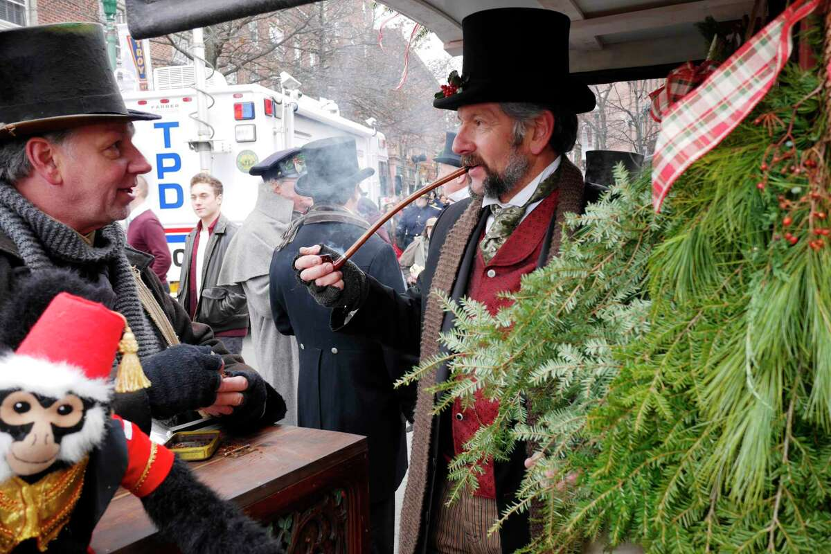 Stephen Piazza, left, of Chatham, and his brother, Erny Piazza of East Postenkill, are dressed in period clothing as they sell wreaths and swags at the Troy Victorian Stroll on Sunday, Dec. 4, 2016, in Troy, N.Y. Erny Piazza began making the wreaths and swags five years ago and getting family and friends to volunteer along with him to sell the items at the stroll with all the money going to JosephOs House. (Paul Buckowski / Times Union)
