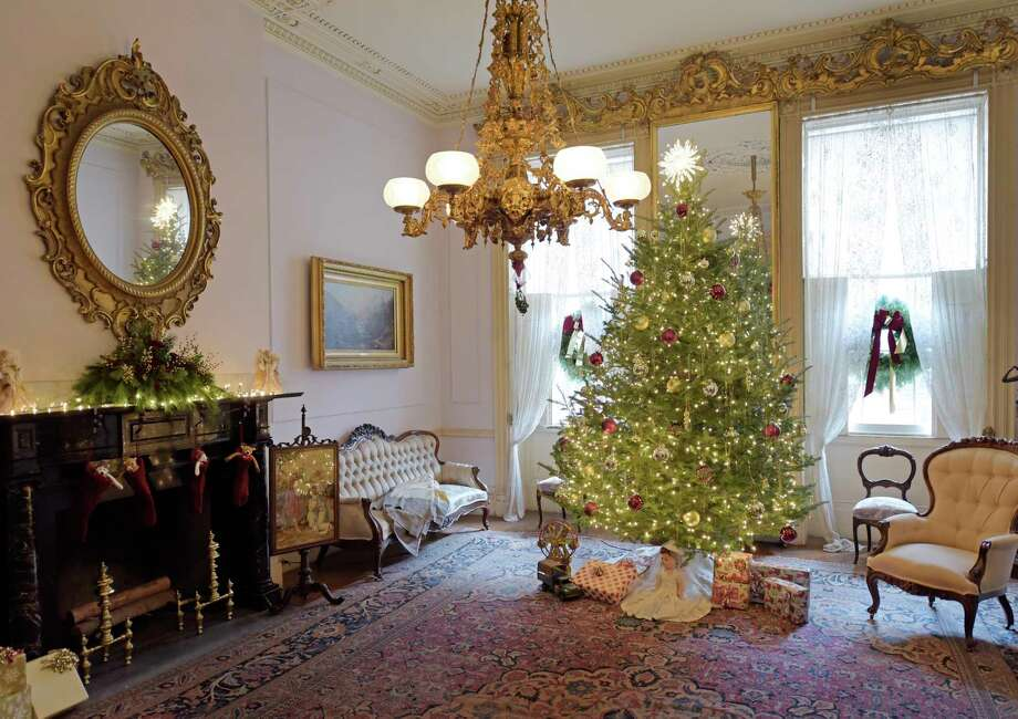 A view of the front parlor at the Hart-Cluett Historic House decorated for the 62nd Holiday Greens Show at the Rensselaer County Historical Society on Wednesday, Nov. 28, 2018, in Troy, N.Y. This year's theme is Childhood Holiday Memories. The 2018 Greens Show runs from Thursday, November 29th through Sunday, December 2nd and is open daily from noon - 5 pm. In addition, Thursday night, November 29th, is a Free Community Night, from 5 pm - 8 pm with free admission, holiday crafts for children, a visit by Santa and a reading of a holiday story. new this year is the guided Lantern Light Tours on Friday, November 30th, at 6 pm and 7 pm, an intimate guided tour through the mansion by lantern light. Reservations need to made for the lantern tour either online at www.rchsonline.org or by calling 518-272-7232 ext. 11. The 50 members of The Van Rensselaer Garden Club began planning for the show in July. Many of the items created by garden club members and on display in each of the rooms are for sale and can be take home at the conclusion of the four day show. Garden club members also have created wreaths which are for sale for $50 each. Those wreaths can be taken home upon purchase. The funds raised from the sale of items goes towards supporting next years Greens Show.    (Paul Buckowski/Times Union) Photo: Paul Buckowski, Albany Times Union / (Paul Buckowski/Times Union)