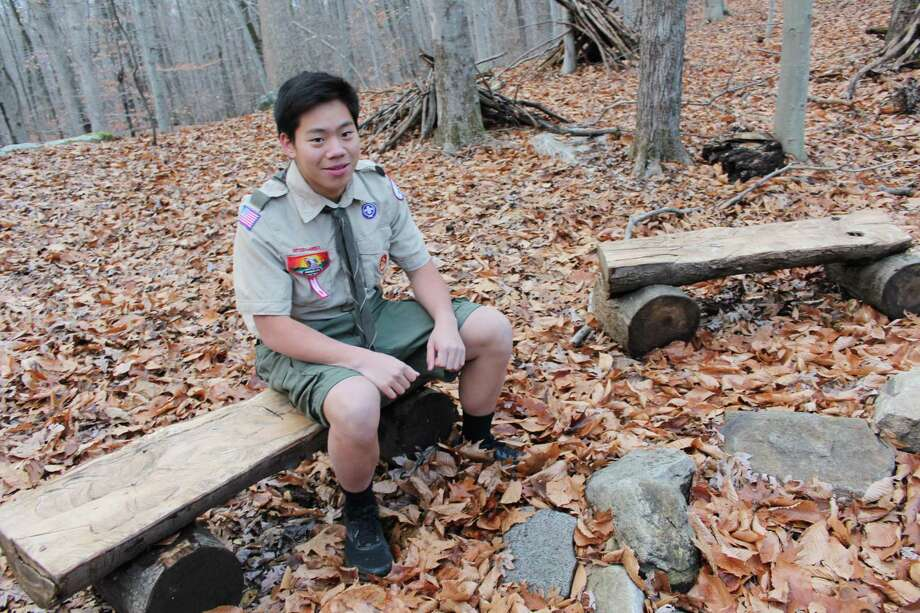 Jonathan Liao, a high school junior, repurposed fallen tree trunks into benches encircling a fire pit of his own design at the Woodcock Nature Center in Wilton as a part of his Eagle Project. Photo: Pat Tomlinson / Hearst Connecticut Media