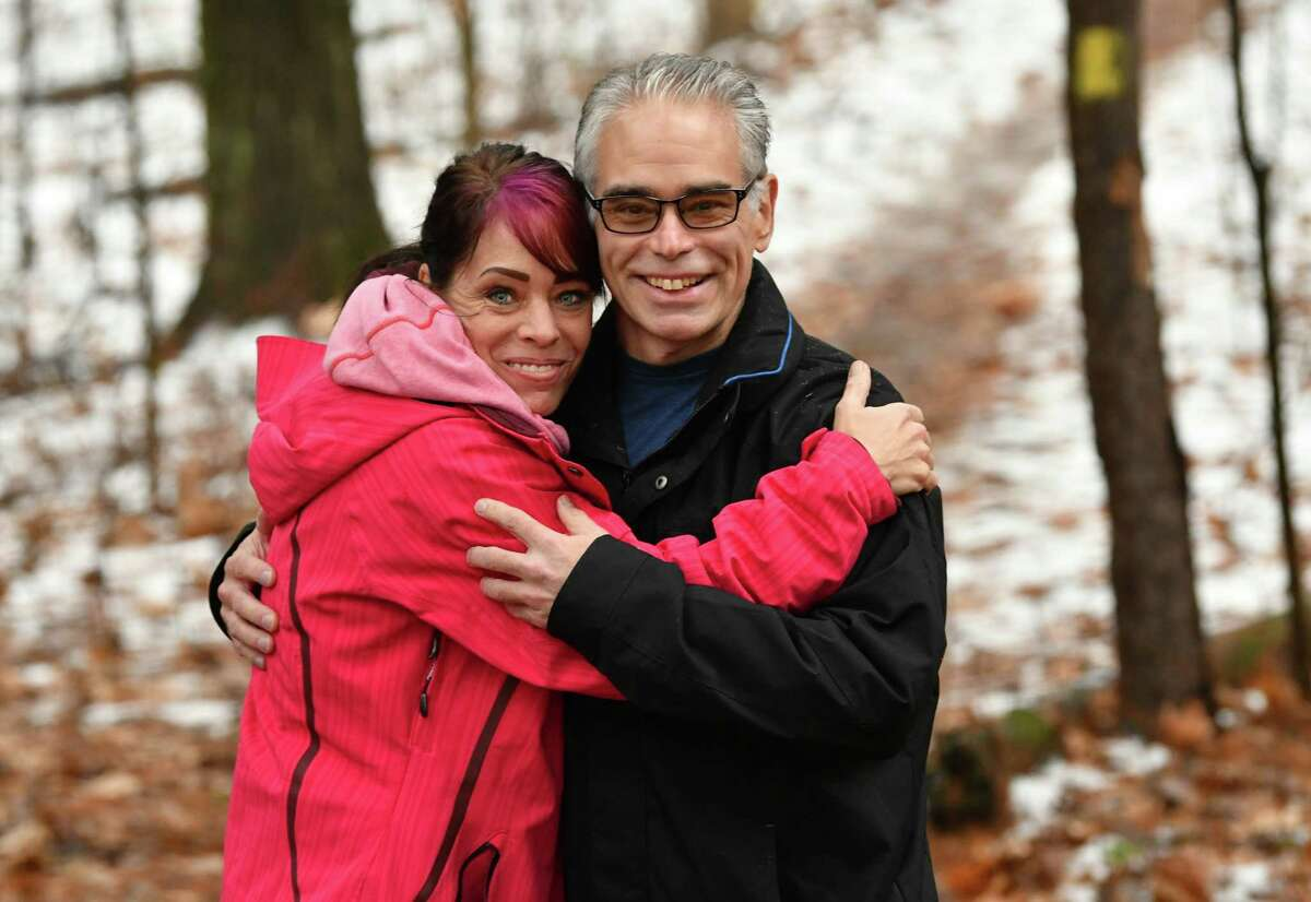 Joi Oleksak of Wisconsin and her brother Matt Riker of Saratoga Springs stand on the trail they will be running this Saturday on Monday, Nov. 26, 2018 in Saratoga Springs, N.Y. Matt, who was recently diagnosed with pancreatic cancer, and his friends will be running in a fundraiser for the Franklin Community Center, where he is a board member. (Lori Van Buren/Times Union)