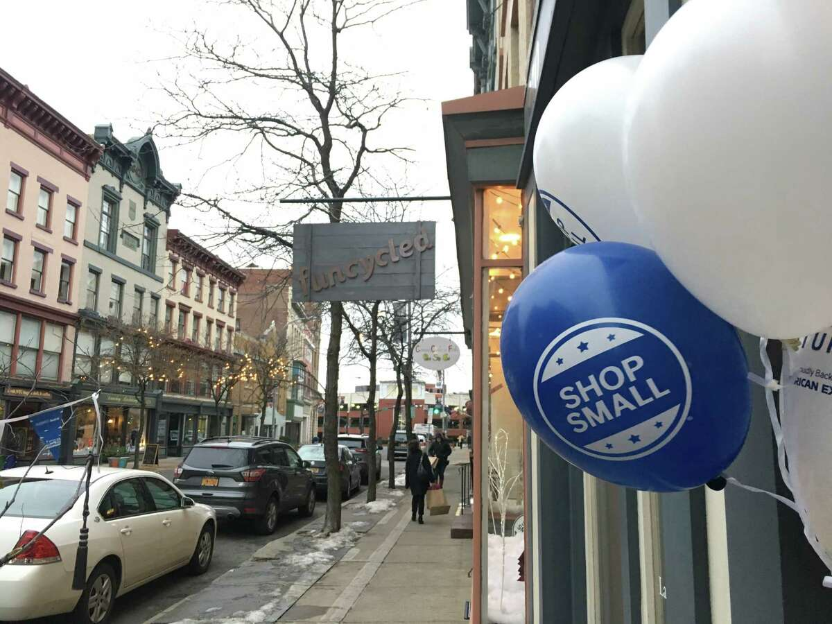 Balloons and decorations welcomed shoppers to downtown Troy on Small Business Saturday. Throughout the country, shoppers spent nearly $18 billion at local, independently-owned businesses.