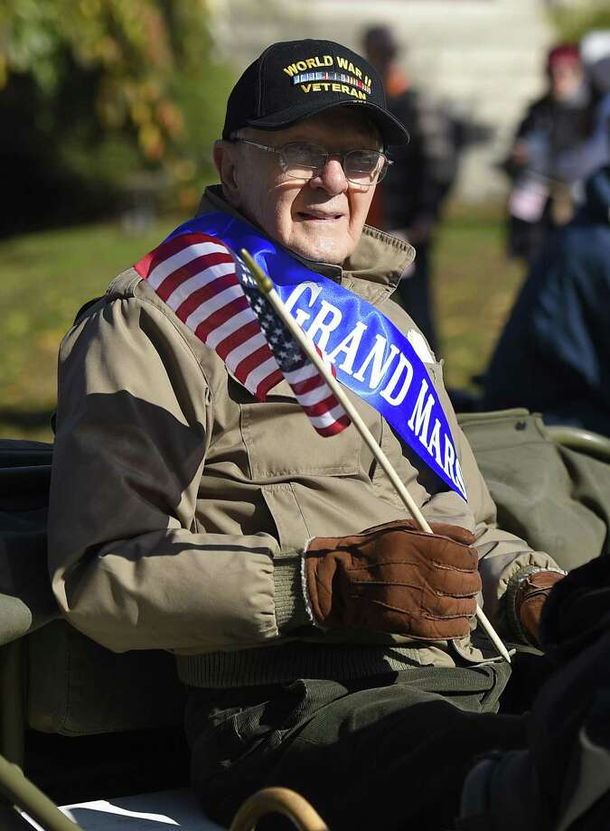 Army aircraft mechanic and flight engineer Sgt. Ted Ogonek, 92, waves to the crowd as grand marshal in the Stamford Veterans Day Parade on Nov. 11. Photo: Tyler Sizemore / Hearst Connecticut Media / Greenwich Time