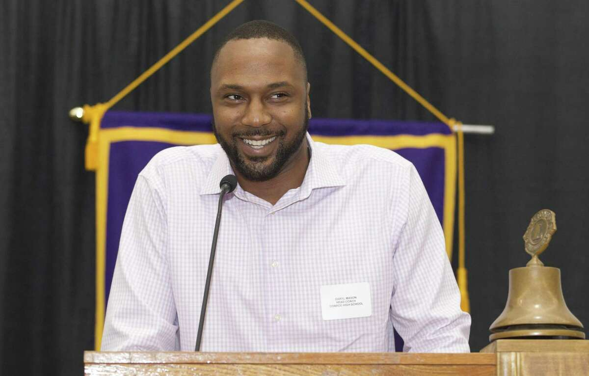 Conroe head coach Daryl Mason shares a laugh during the Conroe Noon Lions Club?'s annual Roundball Roundup with area boys basketball coaches at the Lone Star Convention & Expo Center, Wednesday, Nov. 28 2018, in Conroe.