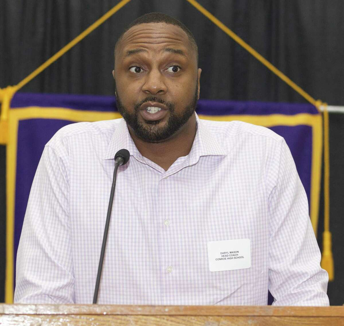 Conroe head coach Daryl Mason speaks during the Conroe Noon Lions Club?'s annual Roundball Roundup with area boys basketball coaches at the Lone Star Convention & Expo Center, Wednesday, Nov. 28 2018, in Conroe.