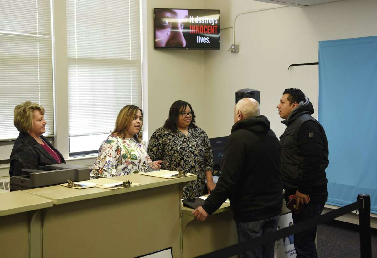 Employees assist customers at the new DMV Express office in Stamford, Conn. Wednesday, Nov. 28, 2018. Located on Henry Street, the office is open Monday through Friday and provides a range of services by appointment only as an alternative to the full-service DMV in Norwalk.