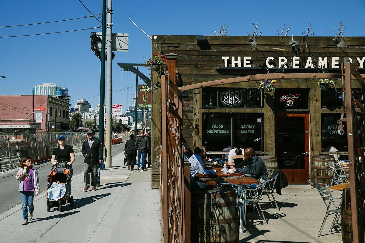 People walk by The Creamery in San Francisco, Calif., Tuesday, Feb. 27, 2018.