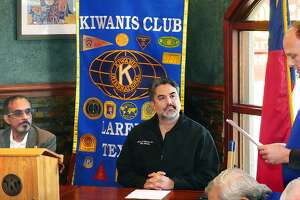 Laredo Kiwanis Club President Alan Jackson introduced L. Vish Viswanath and Dr. Marte Martinez, candidates for the City Council District 6 runoff race, at the club's meeting Tuesday at a Danny's Restaurant.