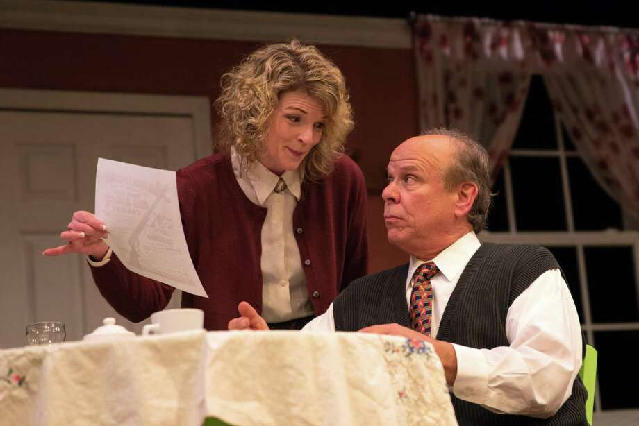 """Vicky Sosbe, as Ralphie's mom, and Dennis Walsh, as Ralphie's dad, rehearse for """"A Christmas Story,"""" onstage at the Sherman Playhouse through Dec.22. Photo: Trish Haldin Photography / Contributed Photo"""